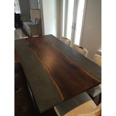 910 Castings Concrete dining table with live edge slab