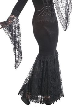 Zaynab is a long gothic Morticia-style skirt by Sinister. It has a fishtail of black lace trimmed with Venetian lace over an inner black satin skirt.