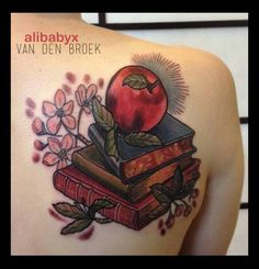 This is my sixth tattoo, done by Tan Van Den Broek at Pure Vision Tattoo in Fitzroy, (Melbourne, Victoria, Australia).   I told her that I wanted a pile of antique books with an apple sitting on top, and this is what she came up with. It is absolutely perfect. The books represent my love of reading and learning/knowledge. In combination with the apple they are a tribute to both my parents and all four of my grandparents as they are all teachers. The apple blossoms are largely for decoration.
