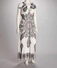 Loving this Ivory & Black Arabesque Puff-Sleeve Maxi Dress on #zulily! #zulilyfinds