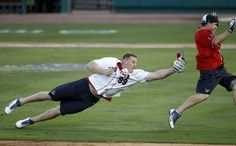 J.J. Watt dives to tag out Case Keenum during the softball game.