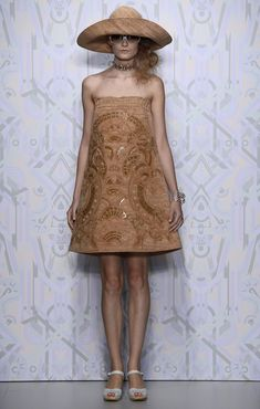 And if you ever wondered what a dress made from cork would look like (because, why wouldn't you?!) you can find out after the jump. It was o...