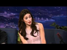 Emmy Rossum Sings Opera For A Hot Dog - Conan on TBS. No that's not a euphemism. Check out Conan's expression, as I don't think he realized just how wonderful she is.