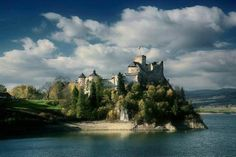 Niedzica castle, Poland  Niedzica Castle also known as Dunajec Castle, is located in the southernmost part of Poland in Niedzica. It was built between the years 1320 and 1326 on the site of an ancient stronghold surrounded by earthen walls in the Pieniny mountains. The Niedzica Castle stands at an altitude of 566 m, on a hill 300 m upstream from the Dunajec River mouth, from the center of the dam on Czorsztyn Lake.