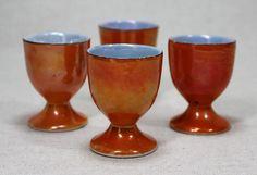 "Vintage Set of 4 Orange Luster With Black Trim Ceramic Footed Egg Cups 2 1/4"" . Happy breakfast"