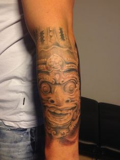 Black and white aztec mask tattoo