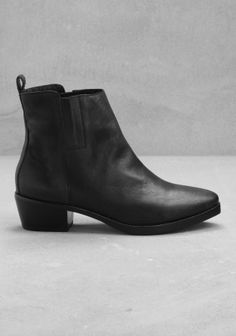 & OTHER STORIES Low heel, leather ankle boots with a Western-style silhouette. - Squared welt design across the front of the toe- Hidden elastic panels on each side of the ankle for flexibility- Leather tab - Cushioned leather insole and a leather and rubber outsole- Heel height: 5 cm