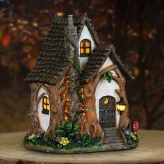 Fairy Homes and Gardens - Solar Tree Trunk Fairy Cottage, $45.99 (https://www.fairyhomesandgardens.com/solar-tree-trunk-fairy-cottage/)