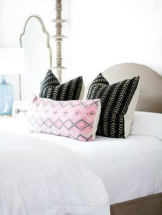 Mud cloth pillows are in! They add texture and depth to any room. Designer Becki Owens used Euro-sham-sized mud cloth pillows in the bedroom with crisp white sheets and a pop of pink.