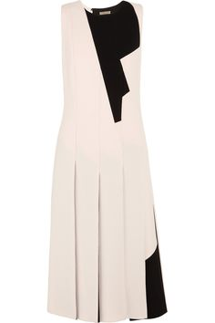 """BOTTEGA VENETA Two-tone pleated wool-crepe dress -    """"Graphic slicing and puzzling"""" are the focus of Bottega Veneta's Fall '14 collection. Worn on the runway at Milan Fashion Week and fully lined in stretch-silk, this off-white and black wool-crepe dress is gently nipped-in at the waist. It moves elegantly through the skirt thanks to the fluid knife pleats."""