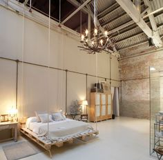 Industrial Style Bedroom Design: The Essential Guide : Industrial bedrooms exude calm and cool. Exposed brick walls, iron finishes and unpolished floors carry the creativity of the artist – and what better way to Master Suite Bedroom, Rustic Master Bedroom, Home Decor Bedroom, Rustic Bedrooms, Bedroom Ideas, Brick Bedroom, Loft Bedrooms, Modern Bedrooms, Bedroom Wall