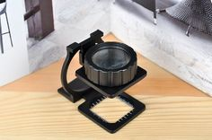Itemship 20 times the full metal jewelry printing special portable magnifier with reading folding cloth mirror by Itemship, http://www.amazon.ca/dp/B00GLLMKDC/ref=cm_sw_r_pi_dp_LiKGsb1QAG4XE