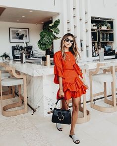 Pretty ruffled orange dress.