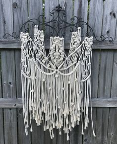Macrame wall hanging on wrought-iron