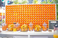 8/28/2013: Wall of oranges with fresh-squeezed juice by @ThisIsMKG for @jcpenney. Photo: Nadia Chaudhury/BizBash