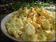 (Awesome Recipe!! - Simple Southern Potato Salad Recipe - suggestions: For even more flavor, cook potatoes in chicken broth (or at least put salt in the water), substiture dijon mustard for yellow mustard for a softer taste & add a little white vinegar to give it a twang. I also add sliced green olives, chopped celery and celery seed and sprinkle with Paprika. - Southern.Food.com