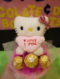 Hello Kitty doll bouquet with 3 Ferrero Rocher chocolates. *** Cute Valentine's day gift!