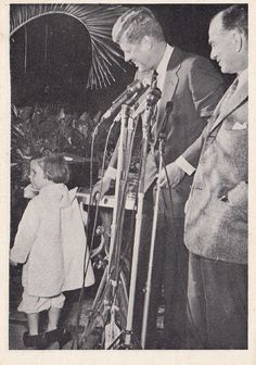 Caroline Kennedy interrupts her father's press conference by clomping in wearing her mother's heels.