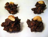 """Sugar-free chocolate and nuts are mixed to make these easy, delicious cluster candies. You can use any nuts you prefer. Be sure to buy """"diabetic"""" or """"sugar-free"""" chocolate (made with sugar substitutes), not unsweetened chocolate."""