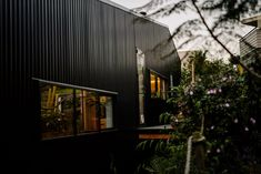 A striking, contemporary home designed for a growing family in the picturesque beach side location of Waihi Beach.  Clad in black steel and cedar this sophisticated home perfectly captures the essence of relaxed, laid back beach living.
