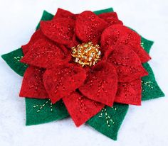 My felt poinsettia pin.  Hand stitched petals and leaves and hand beaded center.