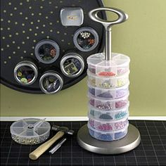 That's a pizza baking pan with magnetic canisters for storing little scrapping stuff.  Great idea!  Stack fishing tackle boxes that have snap-close lids on a paper towel holder for easy organization. Another great idea