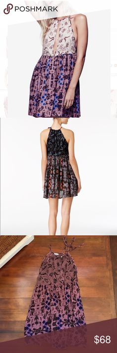 "NWT Free People Wildest Dreams Printed Shift Dress Free People's breezy shift dress is the ultimate in effortless style and feminine charm. Rayon, hand wash, halter neckline, front keyhole closure, sleeveless, all over print, shift silhouette, hits above knee, approx. 33"" length Free People Dresses"