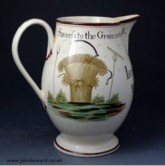 Antique English creamware pottery pitcher named and dated 1791 with Farming motifs and legends.