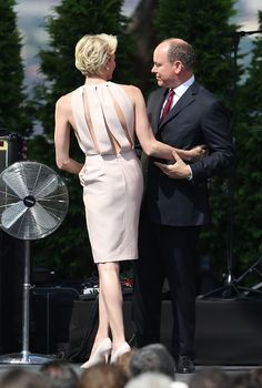 Princess Charlene of Monaco and Prince Albert II of Monaco embrace during celebrations marking Prince Albert II's decade on the throne, on July 11, 2015 at Monaco's palace.