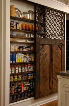 A spice wall with barn doors.