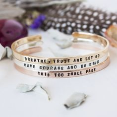 Share your authentic truth with this personalized inspirational skinny cuff bracelet available in sterling silver, brass, and copper. This hand stamped quote bracelet can be completely personalized and customized with unique symbols and phrases to reflect the unparalleled perfection of all that you are. Have your favorite mantra placed on the outside as a fearless reminder or on the inside as a secret message just for you! This cuff is the perfect gift for your favorite soul seeker or a…