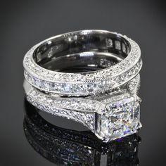platinum engagement ring is showcasing a 1.94 G VS1 Asscher set with 22 Asscher cut diamonds and 60 A Cut Above Melee diamonds. The matching diamond band is scattered A Cut Above Diamond melee.