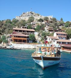 Simena Castle ruins sit atop the hill the town is built on. The climb is a challenge on a hot, dry day but the views are magnificent and more than make up for your efforts.  Kekova - Turkey's Spectacular Sunken City   The World is Waiting http://www.theworldswaiting.com/2013/07/kekova-turkeys-spectacular-sunken-city.html
