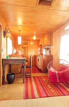 Inside of a trailer at El Cosmico Glamping Resort in Marfa, Texas. Click thru to Check out the rest of their quirky accommodations.LOVE that rug. Rv Living, My Living Room, Small Living, Living Spaces, Mobile Living, Airstream Interior, Trailer Interior, Airstream Decor, Airstream Living