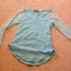 Abercrombie light blue shirt. Abercrombie and Fitch light blue 3/4 sleeved shirt. in the right arm it has a stain. Abercrombie & Fitch Tops