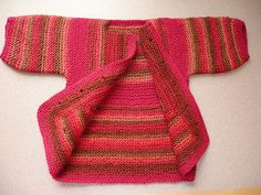 Baby Surprise Sweater by E. Zimmerman, knit with some yarn from JoAnns.  Before buttons were attached.