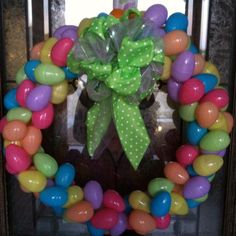 My Easter Egg Wreath... Lots of Dollar Tree Plastic Eggs, Dollar Tree Ribbon, and hot glue...