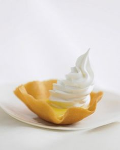 """See the """"Lemon Tartlets with Meringue Caps"""" in our Bite-Size Desserts gallery"""