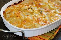 Thinly sliced yukon gold potatoes, layered and baked in a light buttery sauce and shredded cheese. So good without the guilt!