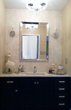 Bathroom Makeover - mother of pearl mop tile backsplash, black cabinets, quartz countertop: