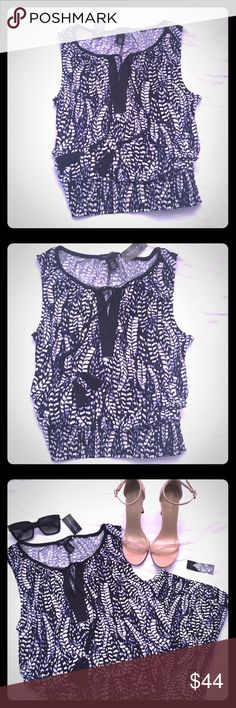 """🌸WHBM Sleeveless Smocked Waist in """"Feather"""" Print NWT WHBM Sleveless Top w/smocked waist. The neckline has a drawstring style that makes the top extremely versatile. I love all the different looks this top can provide! The """"Feather"""" pattern combines noble blue, black and white. The drawstring has a small silver detail on each end, above the knot. Size small, although in my opinion it could fit an XS or a M depending on the look you want! 95% polyester, 5% spandex blend. White House Black…"""
