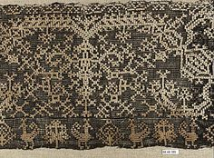 Fragment  Date: ca. 1600  Culture: Italian  Dimensions: H. 26 x W. 14 inches (66.0 x 35.6 cm)  Classification: Textiles-Laces-Cutwork  Accession Number: 79.1.105