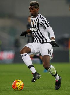 Paul Pogba Photos - Paul Pogba of Juventus FC in action during the TIM Cup match between SS Lazio and Juventus FC at Stadio Olimpico on January 20, 2015 in Rome, Italy. - SS Lazio v Juventus FC - TIM Cup