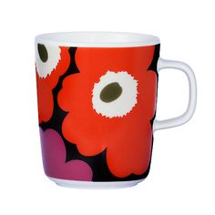 marimekko mug in coral red is a new release from Finnish label Marimekko.  Pass by in our store in Utrecht NL to have a look...or visit our webshop www.emma-b.nl