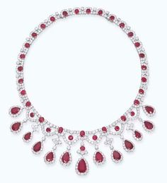 RUBY AND DIAMOND NECKLACE  Designed as a fringe of thirteen pear-shaped rubies within a brilliant-cut diamond surround to the ruby and brilliant-cut diamond necklace with detachable sizing strip, mounted in 18k white gold, 43.5 cm or 38.0 cm long Accompanied by report no. 45295 dated 16 September 2005 from the SSEF Swiss Gemmological Institute stating that the rubies are of Burmese origin, no indications of heating (2)