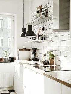 Scandinavian apartment with industrial and mid-century modern touches…