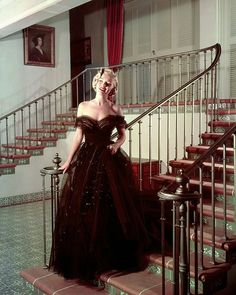 A gorgeous photo of Marilyn Monroe in a strapless ballgown posing on a staircase. It's nice to see her wearing something a little different isn't it? I'm not sure when this photo was taken, but I'm guessing early 1950s?