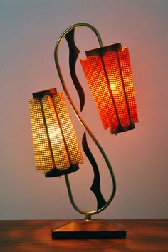 Mid Century Majestic table lamp with dual orange and beige fiberglass shades