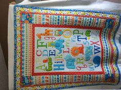 This sweet quilt is quilted by:  Faith McLeod