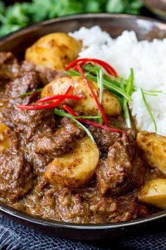 Slow Cooked Beef Massaman Curry - Rich, fall-apart beef in a spicy homemade sauce with new potatoes. Perfect comfort food! #SlowCooked #Crockpot #Massaman #Curry